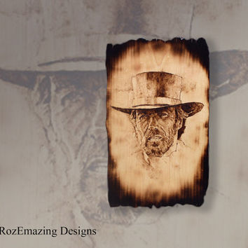 """Clint Eastwood Pyrography Portrait - A Large Old West Wall Sign on  a 11"""" x 21"""" Distressed & Burned Rustic Maple Plank"""