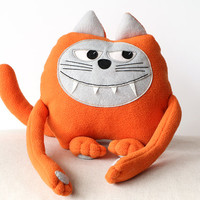 Orange monster cat soft toy.