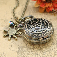 Vintage style star locket necklace with sun charms and crystal charms by mosnos