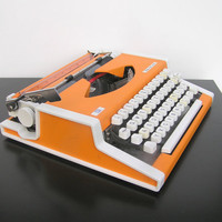Working typewriter Unis TBM de Luxe good working condition orange tangerine lightweight Yugoslavia