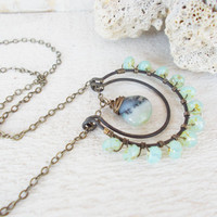 Peruvian opal necklace, wire wrapped artisan jewelry, baby blue czech glass, oxidized brass horseshoe, large double crescent pendant