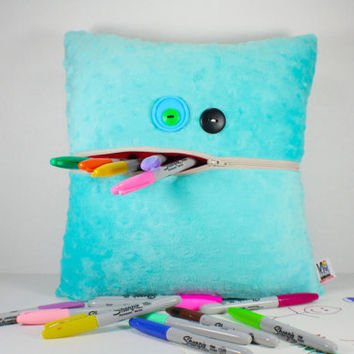 Plush Aqua Monster Pillow with a Tan Zipper Pocket Mouth for Storage and Button Eyes Fun for All Ages
