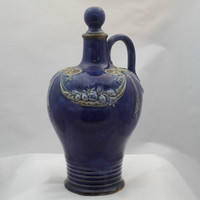 Royal Doulton Whisky Flask / Flagon (1135). Fabulous cobalt blue jug complete with stopper and decorated with garlands and fruit. 1920s