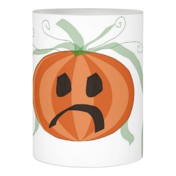 Sad Halloween Pumpkin with a Green Bow Flameless Candle