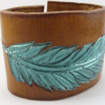 Metallic Teal Feather on Desert Tan background Feather Wrist Cuff Durable 8 oz Leather Hand Made in USA