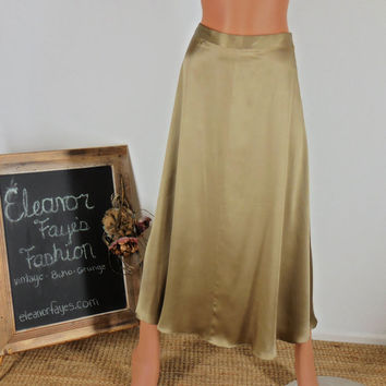 Sze 5 / 6 Vintage classic 1980s liquid gold silk Midi Skirt High Waist Swing Skirt.