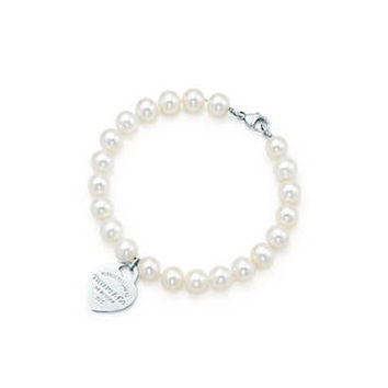 Tiffany & Co. - Return to Tiffany® small heart tag in silver on a freshwater pearl bracelet.