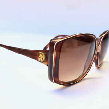 GIVENCHY!!! Vintage 1970s 'Givenchy' oversized tortoiseshell sunglasses with gold logo plates / Made in France