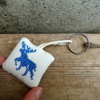 Fabric keychain with a deer. Rustic keychain with floral back. Eco-friendly keychain with nordic style embroidery