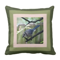 Blue Jay pillow, framed in greens & rosy-nude Throw Pillows