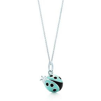 Tiffany & Co. -  Ladybug charm in silver with blue and black enamel finish on a chain, small.