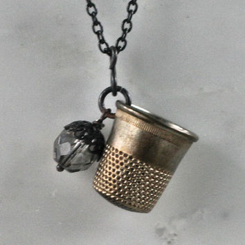 Peter Pan and Wendy Acorn & Thimble Kiss Necklace In Black and Brass