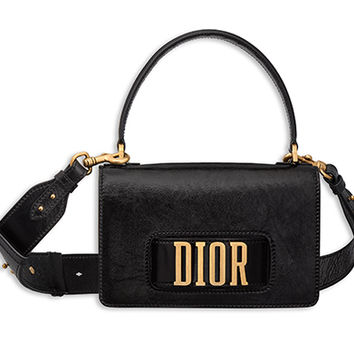 """dio(r)evolution"" flap bag with handle and slot handclasp in black crinkled calfskin - Dior"