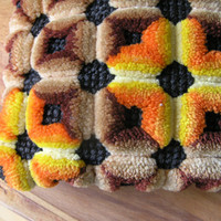 Textured brown tan orange and yellow hook pillow. 60's-70's. Modern look.