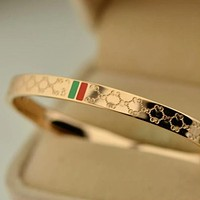 Gucci Plated 18k rose gold titanium steel high-end temperament diamond-shaped red and green bracelet bracelet couple fashion