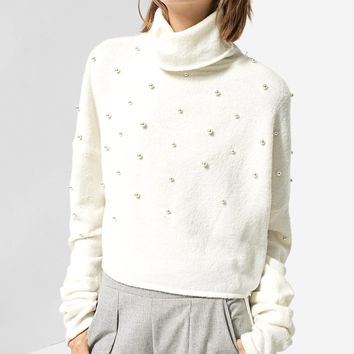 Polo neck sweater embellished with beads - Skirts | Stradivarius Nederland