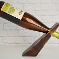 Bullet 25, an espresso mahogany wood gravity wine bottle holder, recycled wood wine display,