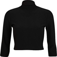 Black textured turtle neck crop top