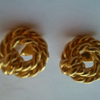 Monet signed clip on goldtone knot earrings. Ideal gift for , birthday or anniversary