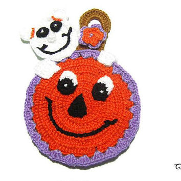 Orange Halloween crochet pumpkin potholder with ghost, presina zucca arancione con fantasma per Halloween all'uncinetto