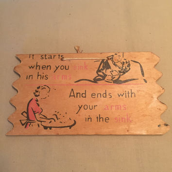 1950's Wooden Post Card/It Starts When You Sink Into His Arms, And Ends with Your Arms In the Sink
