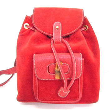 Vintage Gucci red pig suede leather backpack with bamboo trimmings. An elegant but casual bamboo purse for your daily use bag.