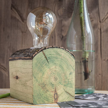 Small and simple wood lamp with green wax finishing made our of reclaimed firewood wood log