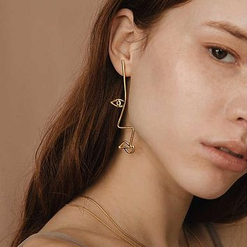 Gold Side Glance Profile Face Earrings