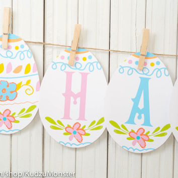 printable easter egg banner reads HAPPY EASTER cute colorful egg shaped bunting flag banner print at home for easter brunch party DIY