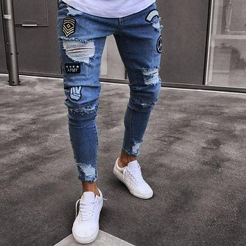 1d752a7ef02 Dropshipping Stretchy Ripped hiphop Jeans Men Cartoon Patch Skin