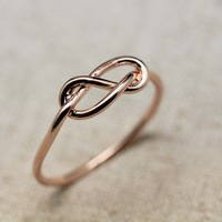 Love Infinity Knot Ring in Pink Gold