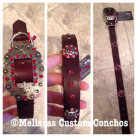 Medium oil 1 inch dog collar. 24 inches in length. Siam and Silver Night Swarovski crystals. Cart buckle and three 1 inch conchos.