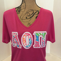 LILLY PULITZER Greek Letter shirt - any letters, stitched on Bella Flowy v-neck t-shirt. Sample: AOPi size Medium ready to ship