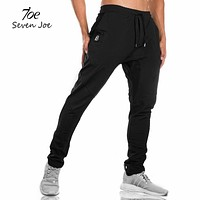 New sweatpants Men's solid workout bodybuilding clothing casual GYMS fitness sweatpants joggers pants skinny trousers