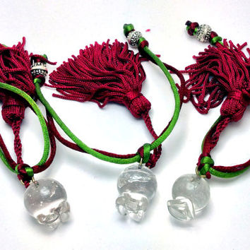 "Good luck ""gouri"" glass pomegranate with metallic beads and dark red and green silk cords and dark red silk tassel"