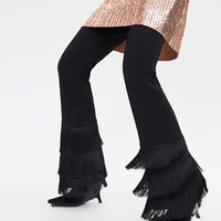 TROUSERS WITH FRINGED HEMS DETAILS