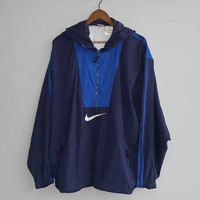 Navy Blue nylon NIKE Front logo swoosh nylon jacket windbreaker hoodie zipper and front pocket, for running training, fits size L