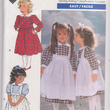 Vintage 1980s pattern by Eileen West for girls long or short sleeved dress with lace trimmed pinafore size 4 5 6 Butterick 4404 UNCUT