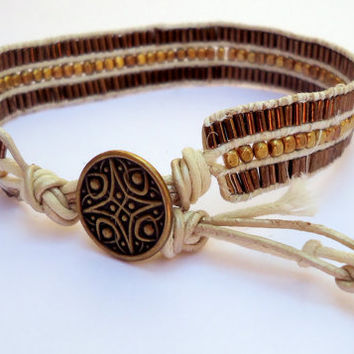 Unisex cuff bracelet,  leather cord bracelet, beaded bracelet, beige and coffee bracelet,gold plated button,Celtic Button