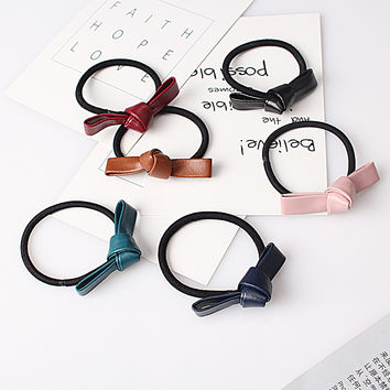 C Sold New Cute Children Girl Leather Bow Elastic Rubber Band Women Bowknot Scrunchy Headdress Accessories Rope Ponytail Holder