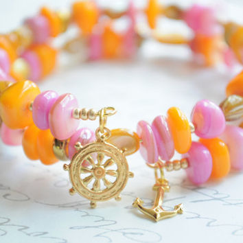 Caribbean bracelet-- Double wrap orange, bronze and pink shell bracelet.  Anchor and wheel charms