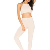 STRUT-THIS The Beau Sports Bra in Nude Chex | REVOLVE