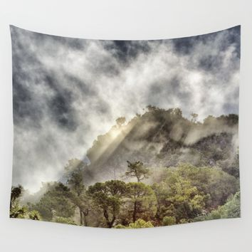 """Sunrays through the foggy forest"". Wall Tapestry by Guido Montañés"