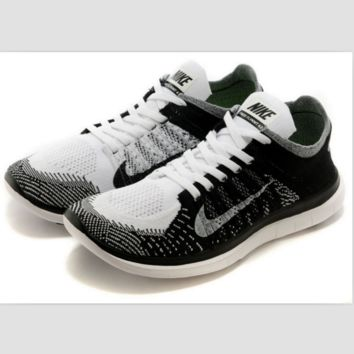 NIKE knitting flying line casual sports shoes White and black