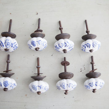 set of FOUR blue and white porcelain knobs / drawer pulls