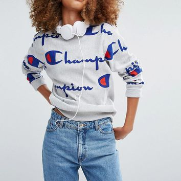 Champion | Champion Oversized Sweatshirt With All Over Logo Print at ASOS