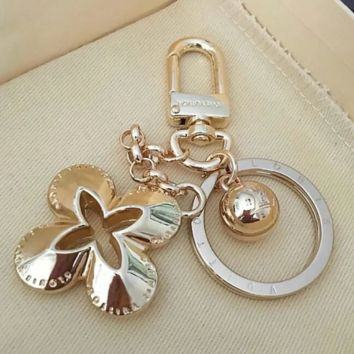 Louis Vuitton LV New fashion jewelry hollow flower four-leaf clover car floral letter key chain