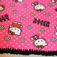 Hello Kitty Fleece single layer Blanket with Black crocheted edges. Measures 60 by 36 inches
