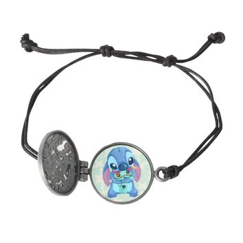 Licensed cool Disney Lilo Stitch & Scrump Ohana Flower Opening Locket Black Cord Bracelet NEW