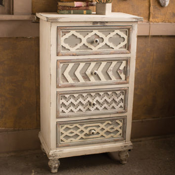 Distressed Wooden Chest with Geometric Drawers
